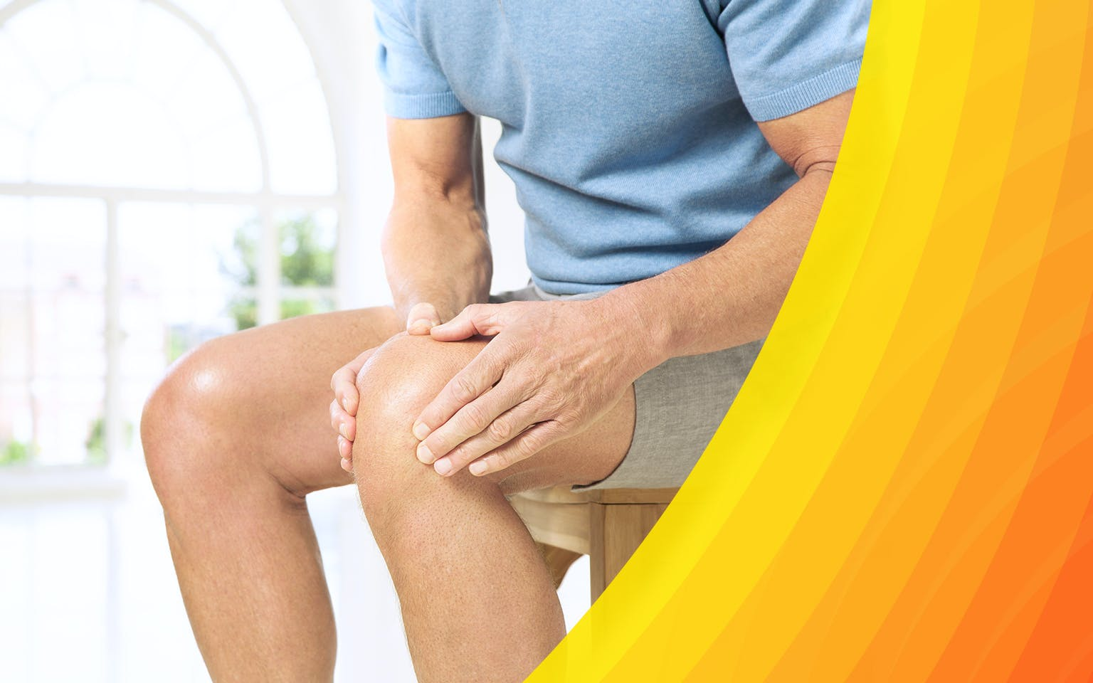 Man's hands holding a painful knee