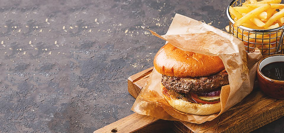 Large hamburger, french fries and gravy dip