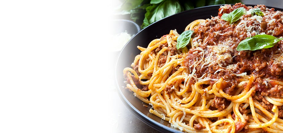 Large plate of spaghetti and meat sauce