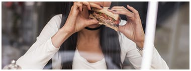 Young woman eating a healthy sandwich