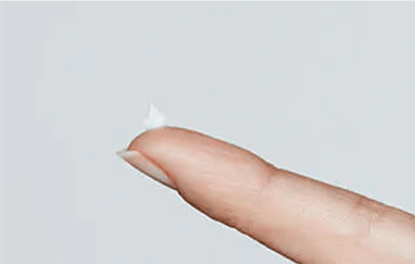 Abreva cream on fingertip for application
