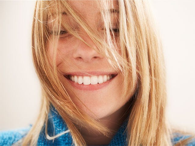 Women smiling and showing her white teeth